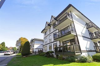 "Photo 1: 106 145 W 18TH Street in North Vancouver: Central Lonsdale Condo for sale in ""Tudor Court"" : MLS®# R2310373"