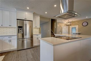 Photo 12: 13608 DEER RUN Boulevard SE in Calgary: Deer Run Detached for sale : MLS®# C4235828