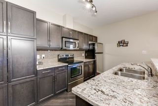 Photo 5: 211 6083 MAYNARD Way in Edmonton: Zone 14 Condo for sale : MLS®# E4150429