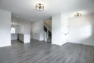 Photo 14: 218 148 Avenue NW in Calgary: Livingston Detached for sale : MLS®# A1013196