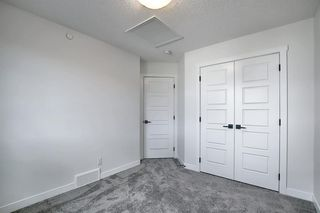 Photo 27: 218 148 Avenue NW in Calgary: Livingston Detached for sale : MLS®# A1013196