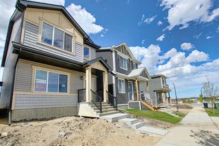 Photo 2: 218 148 Avenue NW in Calgary: Livingston Detached for sale : MLS®# A1013196