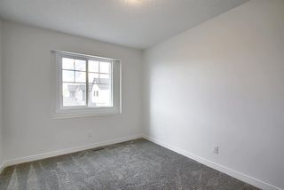 Photo 22: 218 148 Avenue NW in Calgary: Livingston Detached for sale : MLS®# A1013196