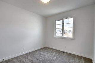 Photo 26: 218 148 Avenue NW in Calgary: Livingston Detached for sale : MLS®# A1013196