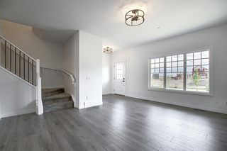Photo 12: 218 148 Avenue NW in Calgary: Livingston Detached for sale : MLS®# A1013196