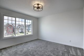 Photo 32: 218 148 Avenue NW in Calgary: Livingston Detached for sale : MLS®# A1013196
