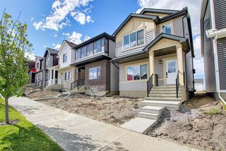 Photo 3: 218 148 Avenue NW in Calgary: Livingston Detached for sale : MLS®# A1013196