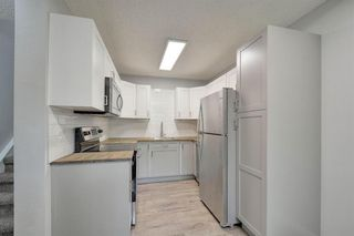 Photo 4: 72 5520 1 Avenue SE in Calgary: Penbrooke Meadows Row/Townhouse for sale : MLS®# A1018683