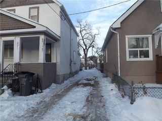 Photo 2: 575 Burrows Avenue Northwest in Winnipeg: North End Residential for sale (4A)  : MLS®# 202100186