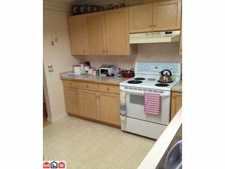 """Photo 2: 231 14861 98TH Avenue in Surrey: Guildford Townhouse for sale in """"MANSIONS"""" (North Surrey)  : MLS®# F1201796"""