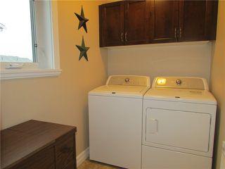 """Photo 14: 10420 109TH Street in Fort St. John: Fort St. John - City NW 1/2 Duplex for sale in """"SUNSET RIDGE"""" (Fort St. John (Zone 60))  : MLS®# N231276"""