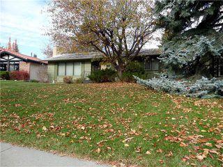 Photo 1: 1039 LAKE WAPTA Way SE in Calgary: Lake Bonavista House for sale : MLS®# C4037311