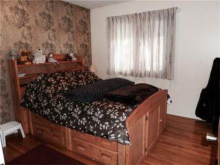 Photo 24: 1039 LAKE WAPTA Way SE in Calgary: Lake Bonavista House for sale : MLS®# C4037311