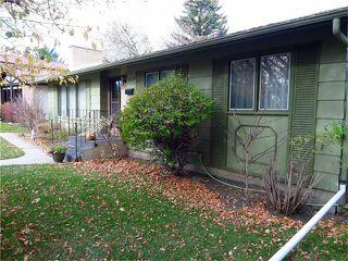 Photo 4: 1039 LAKE WAPTA Way SE in Calgary: Lake Bonavista House for sale : MLS®# C4037311