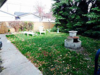 Photo 10: 1039 LAKE WAPTA Way SE in Calgary: Lake Bonavista House for sale : MLS®# C4037311