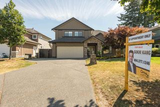 "Photo 1: 7302 146 Street in Surrey: East Newton House for sale in ""Chimney Heights"" : MLS®# R2108687"