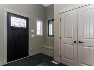 Photo 2: 162 ASPENSHIRE Drive SW in Calgary: Aspen Woods House for sale : MLS®# C4101861