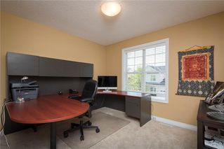 Photo 18: 11 10 ST JULIEN Drive SW in Calgary: Garrison Woods House for sale : MLS®# C4133903