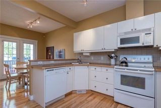 Photo 7: 11 10 ST JULIEN Drive SW in Calgary: Garrison Woods House for sale : MLS®# C4133903