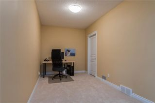 Photo 21: 11 10 ST JULIEN Drive SW in Calgary: Garrison Woods House for sale : MLS®# C4133903