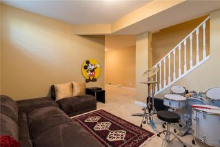 Photo 19: 11 10 ST JULIEN Drive SW in Calgary: Garrison Woods House for sale : MLS®# C4133903