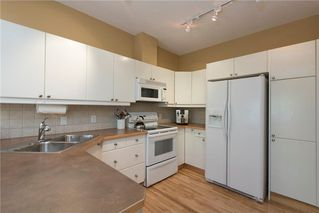 Photo 9: 11 10 ST JULIEN Drive SW in Calgary: Garrison Woods House for sale : MLS®# C4133903
