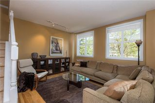 Photo 2: 11 10 ST JULIEN Drive SW in Calgary: Garrison Woods House for sale : MLS®# C4133903