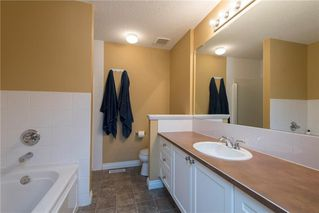 Photo 13: 11 10 ST JULIEN Drive SW in Calgary: Garrison Woods House for sale : MLS®# C4133903