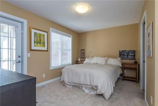 Photo 12: 11 10 ST JULIEN Drive SW in Calgary: Garrison Woods House for sale : MLS®# C4133903