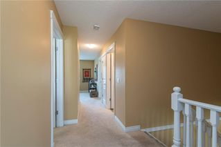 Photo 11: 11 10 ST JULIEN Drive SW in Calgary: Garrison Woods House for sale : MLS®# C4133903
