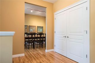 Photo 4: 11 10 ST JULIEN Drive SW in Calgary: Garrison Woods House for sale : MLS®# C4133903