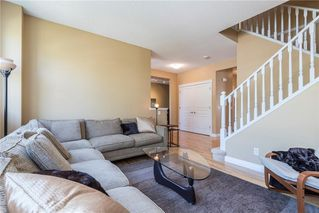 Photo 3: 11 10 ST JULIEN Drive SW in Calgary: Garrison Woods House for sale : MLS®# C4133903