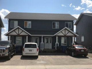 Photo 1: 9211 102 Avenue in Fort St. John: Fort St. John - City NE House 1/2 Duplex for sale (Fort St. John (Zone 60))  : MLS®# R2229819