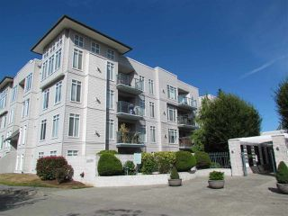 "Photo 1: 203 32075 GEORGE FERGUSON Way in Abbotsford: Abbotsford West Condo for sale in ""ARBOUR COURT"" : MLS®# R2290695"