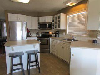 """Photo 4: 11419 98 Street in Fort St. John: Fort St. John - City NE House for sale in """"BERT AMBROSE SCHOOL DISTRICT"""" (Fort St. John (Zone 60))  : MLS®# R2293381"""