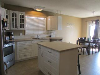 """Photo 5: 11419 98 Street in Fort St. John: Fort St. John - City NE House for sale in """"BERT AMBROSE SCHOOL DISTRICT"""" (Fort St. John (Zone 60))  : MLS®# R2293381"""