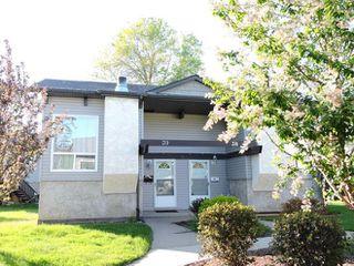 Main Photo: 39 NORTHWOODS Village in Edmonton: Zone 27 House Half Duplex for sale : MLS®# E4127662
