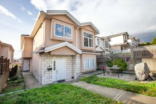 Photo 2: 7845 FRASER Street in Vancouver: South Vancouver 1/2 Duplex for sale (Vancouver East)  : MLS®# R2320801