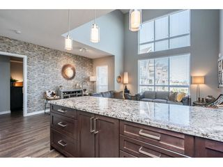"Photo 3: 303 6490 194 Street in Surrey: Cloverdale BC Condo for sale in ""WATERSTONE"" (Cloverdale)  : MLS®# R2489141"