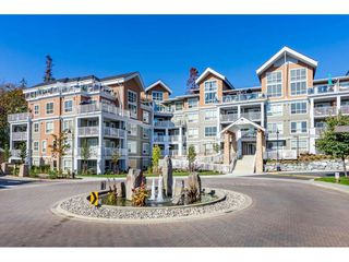 "Photo 1: 303 6490 194 Street in Surrey: Cloverdale BC Condo for sale in ""WATERSTONE"" (Cloverdale)  : MLS®# R2489141"