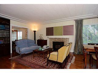 "Photo 2: 406 E 48TH Avenue in Vancouver: Fraser VE House for sale in ""FRASER"" (Vancouver East)  : MLS®# V1066531"