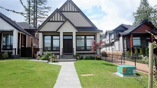 Photo 1: 6333 128A Street in Surrey: Panorama Ridge House for sale : MLS®# R2141263