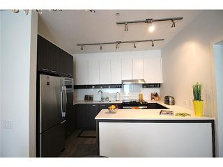 Photo 2: # 209 545 FOSTER AV in Coquitlam: Coquitlam West Condo for sale : MLS®# V1123050