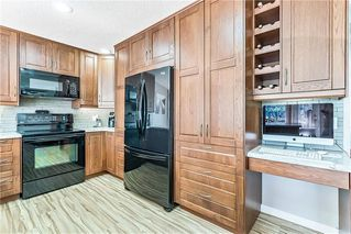 Photo 10: 20 CIMARRON Crescent: Okotoks House for sale : MLS®# C4184646