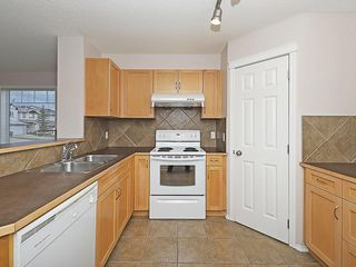 Photo 3: 90 PANAMOUNT Drive NW in Calgary: Panorama Hills House for sale : MLS®# C4188996