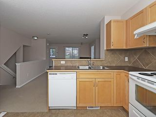 Photo 5: 90 PANAMOUNT Drive NW in Calgary: Panorama Hills House for sale : MLS®# C4188996