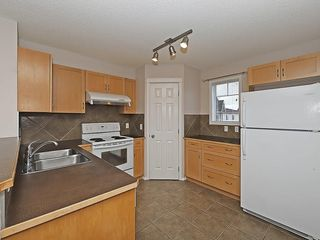Photo 2: 90 PANAMOUNT Drive NW in Calgary: Panorama Hills House for sale : MLS®# C4188996