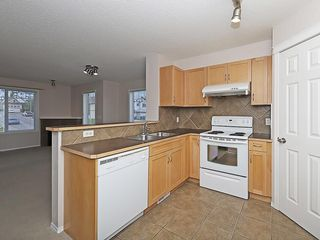 Photo 4: 90 PANAMOUNT Drive NW in Calgary: Panorama Hills House for sale : MLS®# C4188996