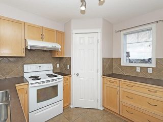 Photo 8: 90 PANAMOUNT Drive NW in Calgary: Panorama Hills House for sale : MLS®# C4188996