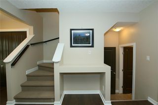 Photo 3: 76 SUNSET Heights: Cochrane Detached for sale : MLS®# C4226992